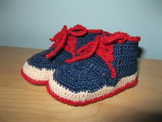 Red, white and blue crocheted baby booties