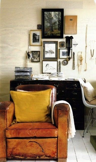 the color and distress of that leather kills me (also really love the cluster of frames and objects on the wall)