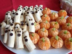 Halloween Bananas with chocolate chips and tangerines with celery stems..... So simple.