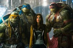 """Animated characters and actress Megan Fox as April, center, appear in the movie """"Teenage Mutant Ninja Turtles."""" Action packed and silly, the latest adoption of the comic book characters is still an enjoyable thrill ride for the family #MovieReview"""