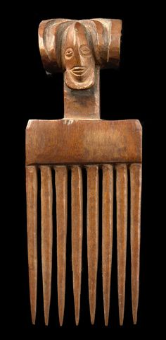 africa b from the chokwe people of dr congo wood and black paint