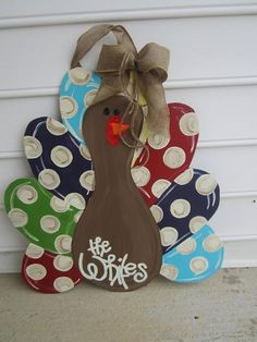 Turkey door hanger on Etsy. I think to make this even more personalized, it would be really cute if you made the turkey's feathers out of everyones shoeprint. :)