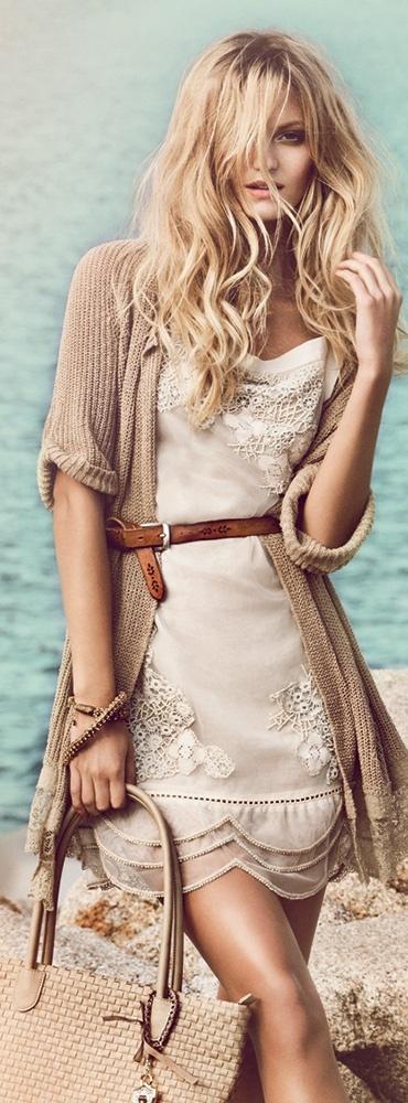 feminine dress with a masculine sweater Nice balance