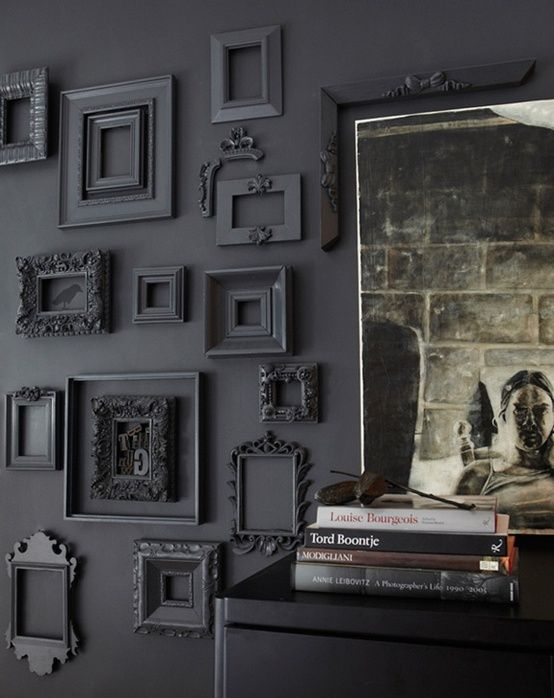 Grey wall with frames painted the same color. Hmm...