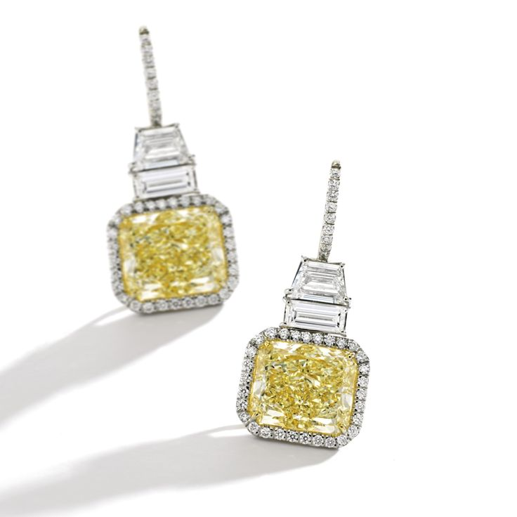 Pair of platinum, 18 karat gold, fancy light yellow diamond and diamond earrings