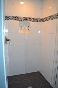 tile shower. slate floor. accent tiles. white tiles ...