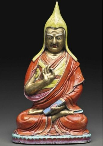 A very rarefamille rosefigure of a Lama, Qianlong Period, dated by inscription to 1782