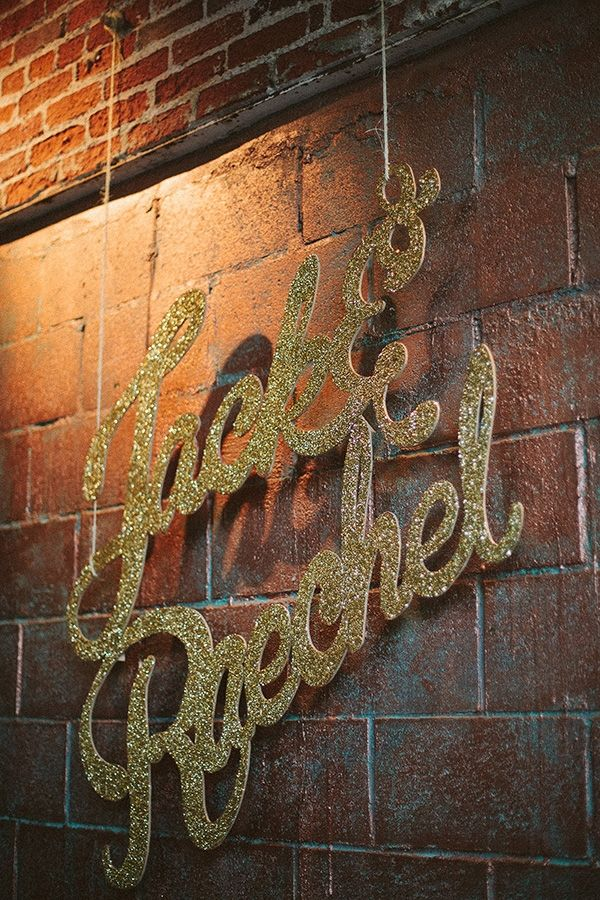 gold glitter sign of the couple's name // photo by ArrowAndApple.com
