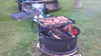 Home made. Tractor tire rim fire pit. With grill racks ...