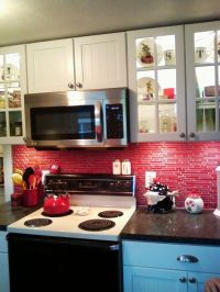 Red glass tile backsplash.