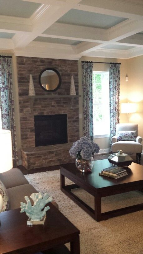 Coffered ceiling stone fireplace. Love