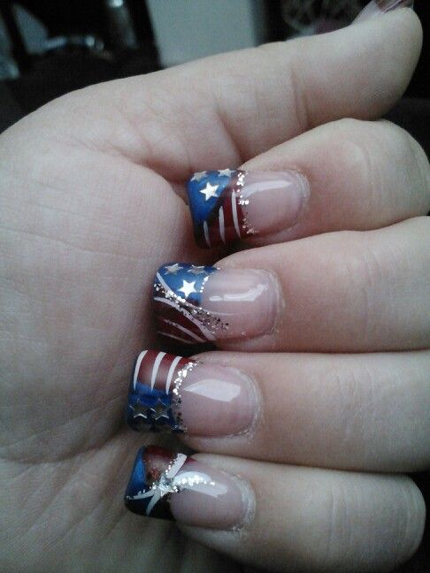 My fouth of july nails....she did a great job getting what i wanted