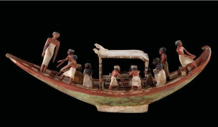 Modèle de barque servant lors d'un enterrement, 12e dynastie, règnes d'Amenemhat II-Sésostris II, vers 1913-1872 av. J.-C. Égypte, Deir el-Bersha. Bois polychrome. H. 49 ; L. 77,5 ; l. 19 cm © 2013 Musée du Louvre/Christian Descamps