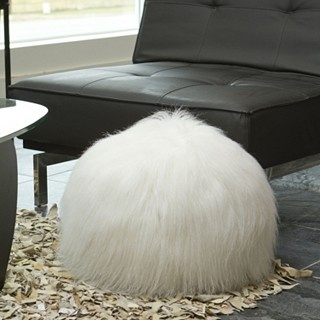 Fluffy fur pillow....cant decide is its posh or scary....