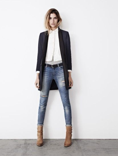 long tuxedo jacket and ripped jeans