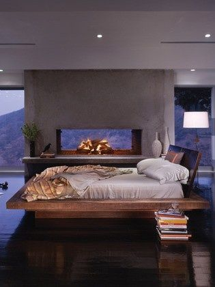 Awesome bedroom with fireplace and view. If it were cold outside, i would turn on the fireplace and stay in bed all day. LOL