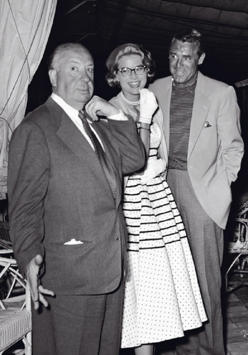 Grace Kelly  with Alfred Hitchcock and Cary Grant.