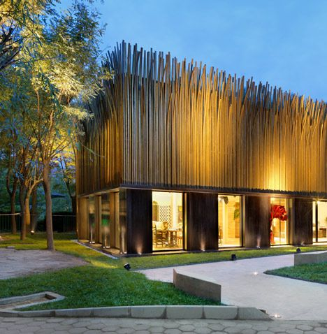 A pavilion in Beijing with a facade covered in 1200 vertical brass tubes