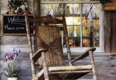 Antique Rocking Chair On Porch
