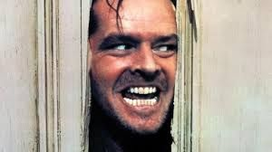 Jack Nicholson in 'The Shining'....unforgettable scene, this one! 'Heeeeeeeeere's Johnny!!!""