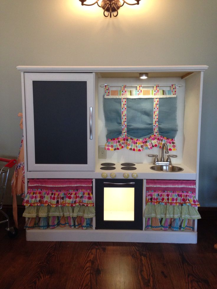 Turn an old entertainment center into a childrens play