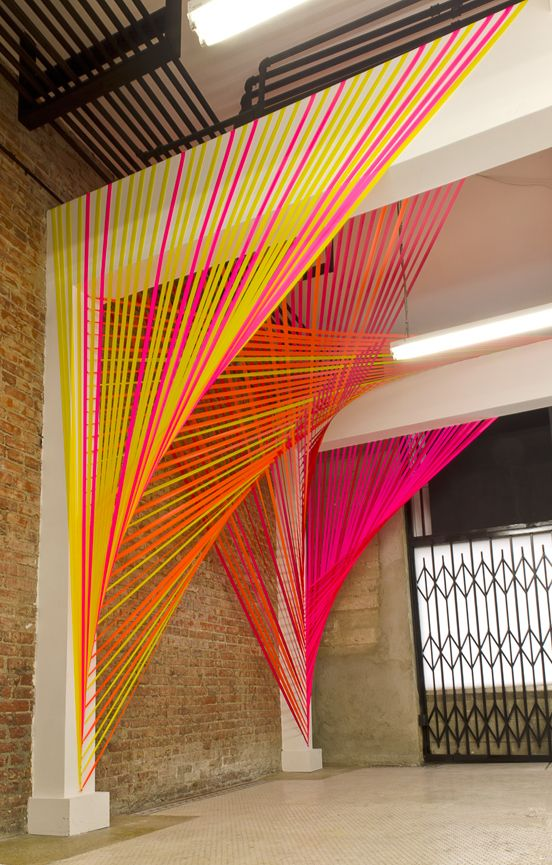 Through looking back you may go blind (2011) - art installation by Megan Geckler; flagging tape, eye hooks and existing architecture
