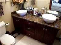 bathroom with raised bowl sinks