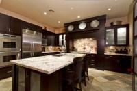 I like the dark cabinets with the light granite   kitchen ...