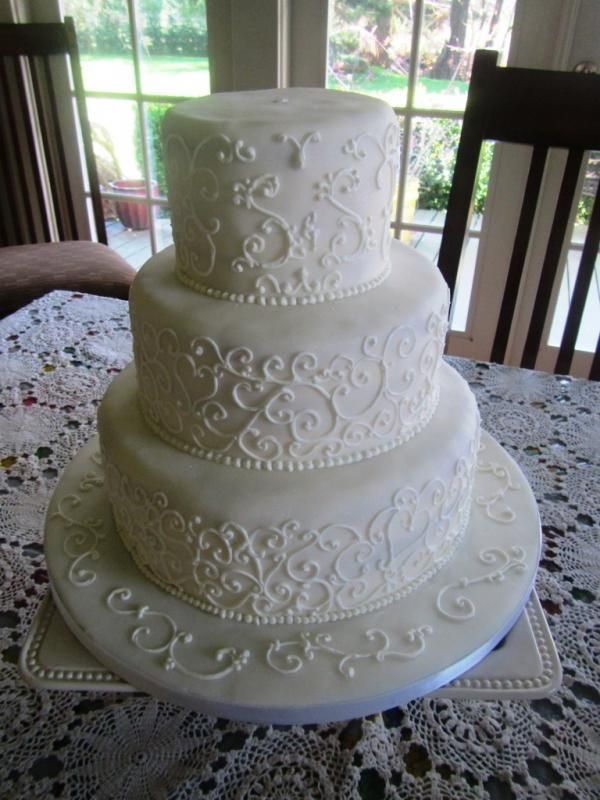 White Filigree Cake. I like the designs on this cake, especially the second tier.