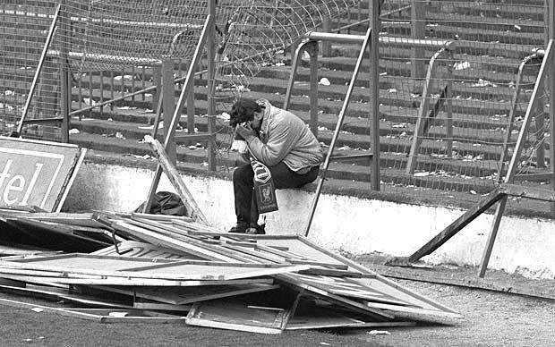 Liverpool supporter - Hillsborough disaster: A fan sits at the front of the Leppings Lane stand where his fellow supporters lost their lives