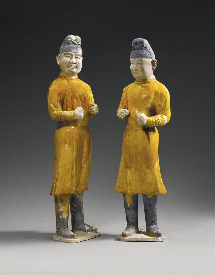 Two large amber-glazed pottery figures of grooms, Tang Dynasty