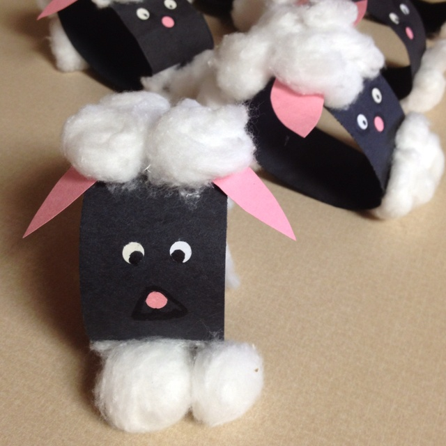 lil easter lamb sheep craft for kids - u will need construction paper, cotton balls, glue stick, hole punch and scissors. Cut out the ears, the long strips of construction paper for the body and punch out the eyes from some scrap white paper and the nose from some scrap pink paper. I used 5 cotton balls and had the kids pull each one in half to make ten total. That makes them the perfect size.