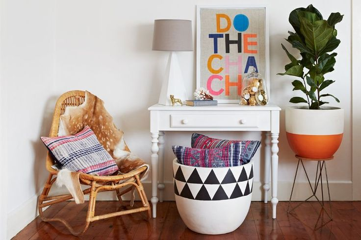 Want a large painted pot and plant in our living room. Really like the orange and white one