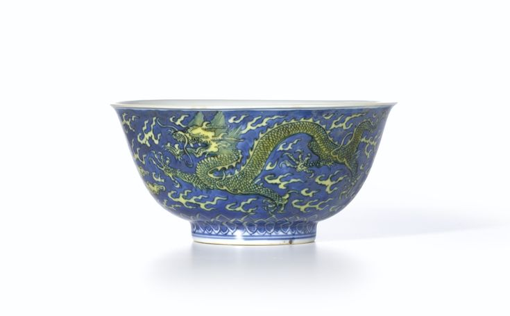 A blue-ground yellow-enamelled 'Dragon and Cloud' bowl, Mark and period of Kangxi