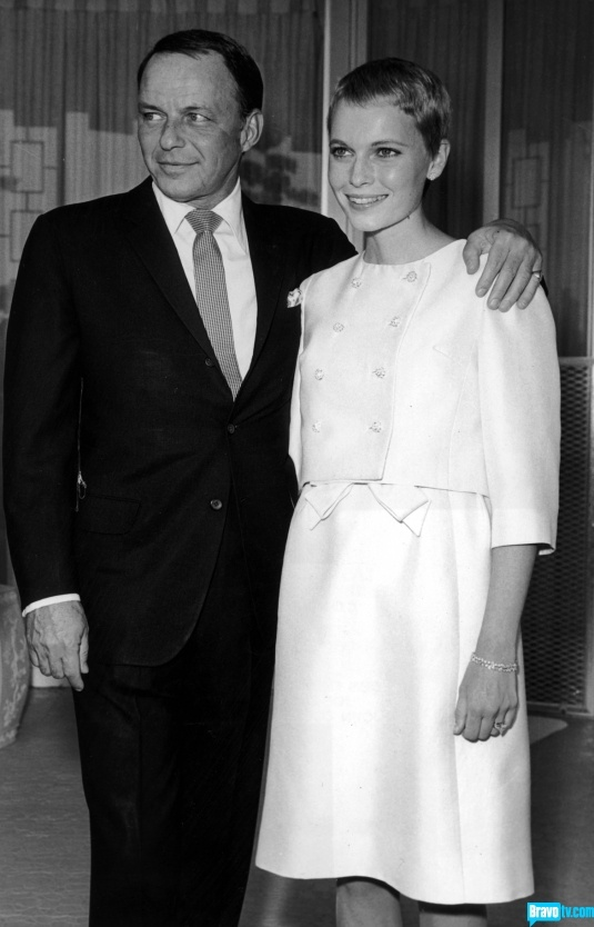 The young Mia Farrow walked down the aisle with Old Blue Eyes himself, Frank Sinatra, in a simple white suit that was perfect 60s mod.