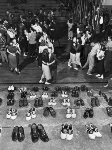 Shoeless                                                                 Teenage                                                              Couples                                                              Dancing in HS                                                              Gym During a                                                               Sock   Hop