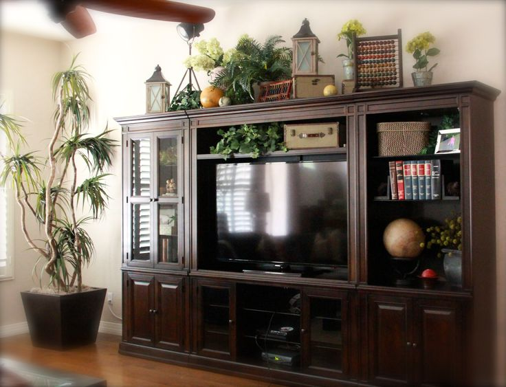 top of large entertainment center  Decorating Ideas