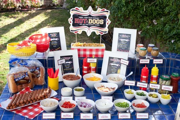 Hot Dog Buffet Bar - Easy, inexpensive way to feed a large group of people! Dress it up with crazy toppings and neat display