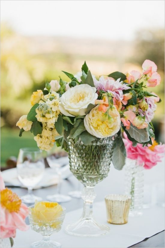 spring floral wedding arrangement #weddingreception #weddingflorals #weddingchicks http://www.weddingchicks.com/2014/02/28/soft-summer-vineyard-wedding/