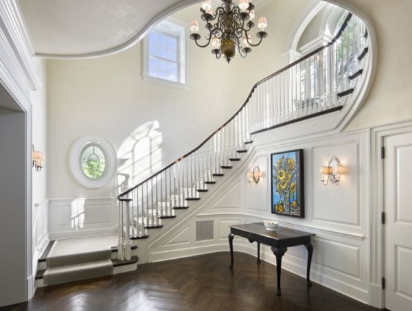 The foyer, stair hall, entrance hall of the beautiful house on Lake Michigan, a Georgian and colonial-inspired home by master architect Robert A. M. Stern