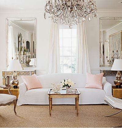 elegant, modern Holly Hunt sofa with traditional and antiques