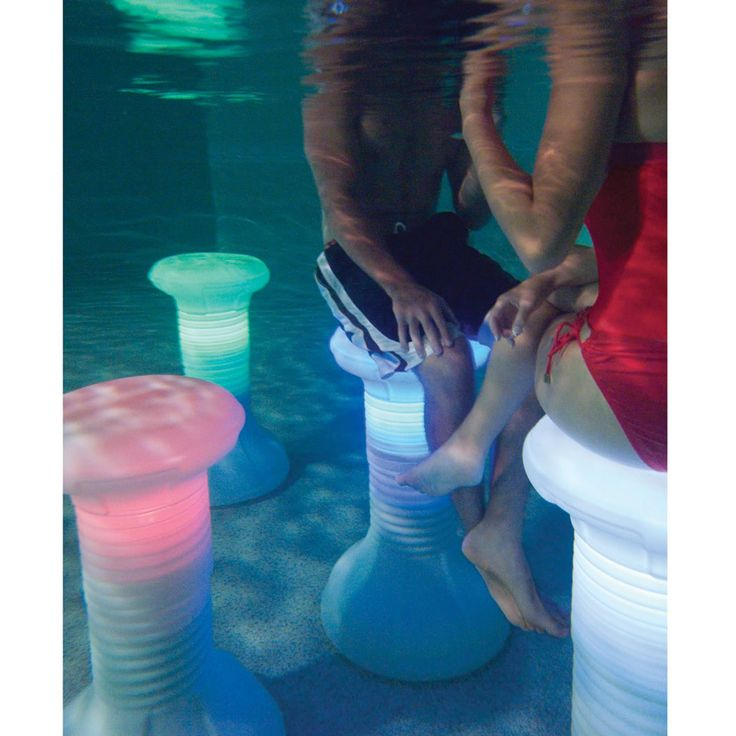 submersible stool that illuminates, ideal for replicating the swim-up bar experience used in finer resorts. A poolside remote control activates the stool's built-in, waterproof four-color LED array that illuminates the stool for optimal nighttime mood lighting.