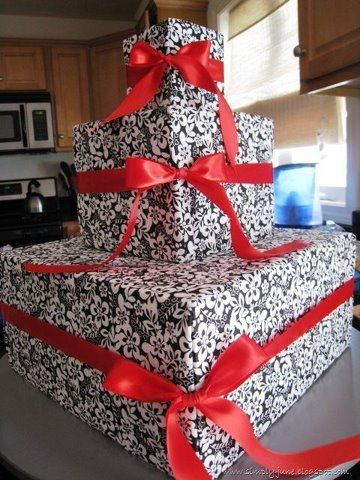 Great - Inexpensive Idea. Make a cupcake stand out of boxes. Wrap boxes to match your party decorations and add ribbon