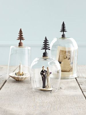 Mini Cloches - Upend ordinary glassware as display domes. To create these super-adorable mini cloches, raid your kitchen.  Glue an iron lamp finial—like a tree, to the bottom of each container with a thin coat of E6000 Multipurpose Adhesive. Let harden for an hour before enclosing tiny treasures underneath.    Read more: Recycled Craft Ideas - Crafts from Recycled Materials - Country Living
