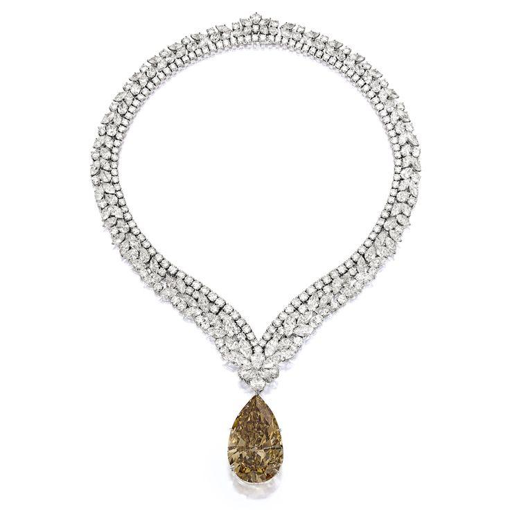 Impressive Fancy Deep Brown-Orange Diamond Pendant; with Diamond Necklace, Cartier | Lot | Sotheby's