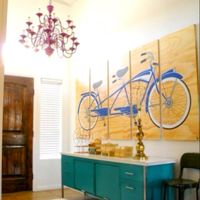 Love the red chandelier and large art