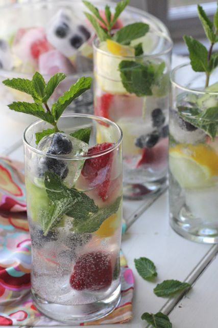 Spritzers with Fruit Ice Cubes - I love these fruit ice cubes for so many different beverages. They are perfect in a fruit punch, sparkly in a glass of lemonade and especially lovely in iced tea.