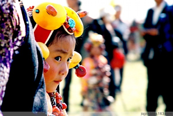 Little girl at the Yushu Horse Festival dressed traditionally. Nomadic ...