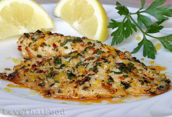 Lemon pepper tilapia  Baked tilapia fillets basted with garlic, butter & olive oil, topped with parsley, paprika and red pepper flakes, then garnished with lemon juice & lemon zest.