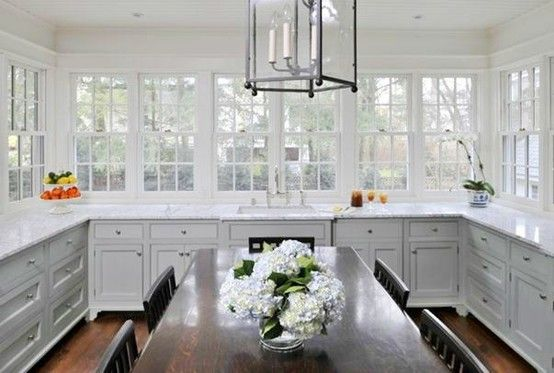 white kitchen, marble counters, dark wood, lantern and tons of windows!
